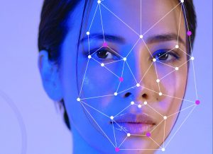 Woman's face overlaid with facial recognition mapping.
