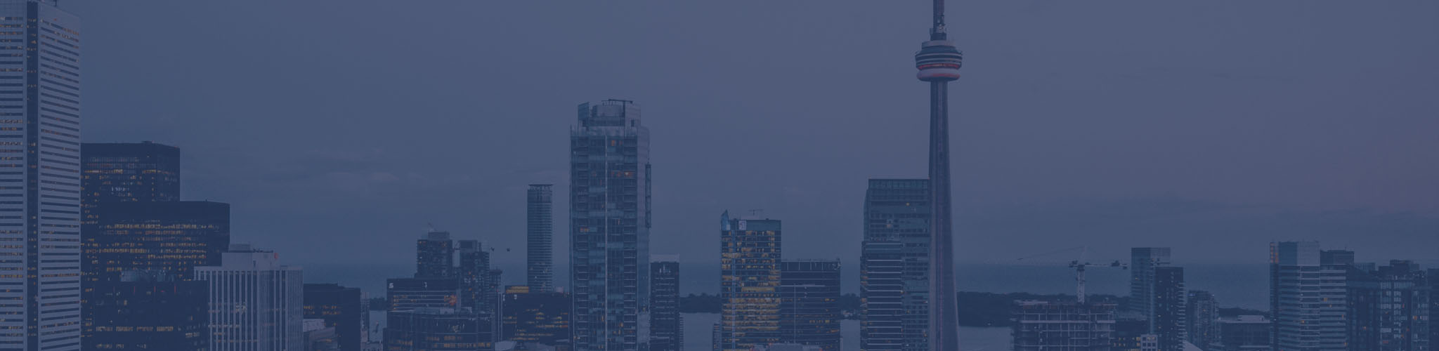 Photograph of downtown Toronto skyline with blue overlay.