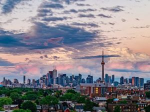 Image of Toronto's skyline by dusk. U of T's School of Cities is strategically located in one of Canada's biggest and most diverse urban hubs