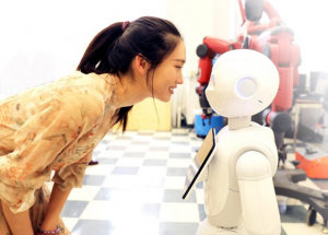 Image of a woman looking at a humanoid robot.